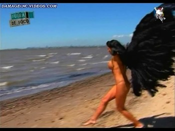 Pamela David topless backstage by the sea